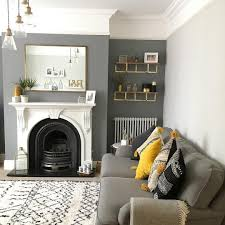 grey and yellow living room plummet on chimney breast and ammonite on wall see this instagram
