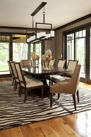 5 rooms featuring a zebra print rug dark wood trim wood trim