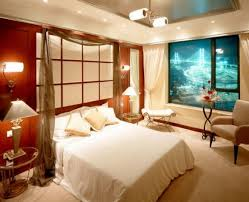 romantic basement bedroom themed using white upholstered bed and