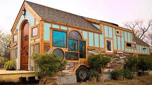 unique birds nest inspired tiny home made out of reclaimed wood