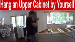 Upper Kitchen Cabinet by How To Install An Upper Kitchen Cabinet By Yourself Youtube