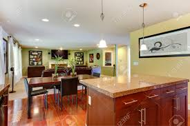 kitchen island with granite top and classic dining table with