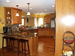 oak kitchen cabinets yellow walls kitchen redo oak cabinets yellow walls black counters