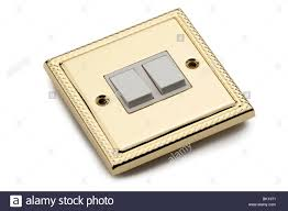 double gold plated electric light switch stock photo royalty free