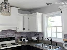 interior cool faux cobblestone veneer backsplash white cabinets