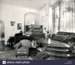 1920s home interiors 1920s interior upscale room with piano and organ stock photo