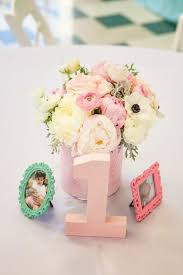 Centerpieces Birthday Tables Ideas by Flowers Photographs In Tiny Frames And A Big Number One Make A