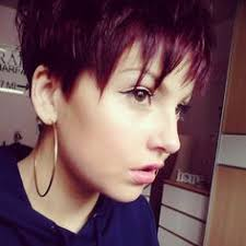 cropped hairstyles with wisps in the nape of the neck for women very cropped front and sides long wisps at ears short haircuts