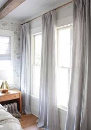 how to hang curtains properly 8 clever and cozy fixes for every major bedroom complaint