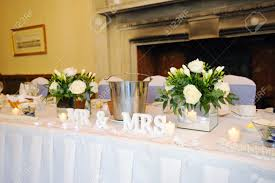 mr and mrs table decoration top table at wedding reception showing mr mrs decoration stock