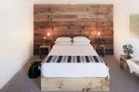 wooden wall bedroom at the graham co a catskills hotel bedrooms feature rustic