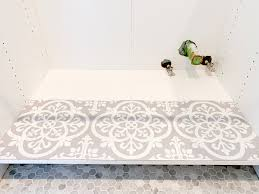 how to cut tile around cabinets how i used pretty peel stick tile to protect my sink cabinets