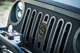 jeep grill logo angry jeep wrangler gets three custom new grilles from strut they all