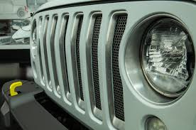white jeep with teal accents 2018 jeep wrangler grille hides in plain sight in easter jeep
