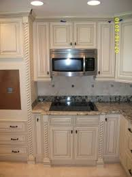 off white kitchen cabinets with dark floors antique off white