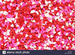 valentines day candy hearts valentines day candy heart sprinkles background stock photo