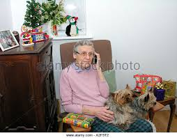 what to get an elderly woman for christmas elderly woman talking to friend by telephone stock photos