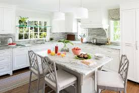 gray kitchen island with gray bamboo counter stools transitional