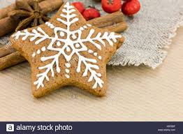 baked at home christmas star shaped gingerbread cookies on brown
