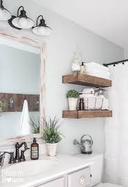 how to decorate bathroom shelves above the toilet realie