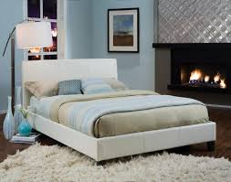sweet modern bedroom design with creamy bed incorporates carving