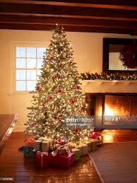 christmas tree and presents in living room stock photo getty images