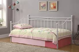 white metal bed frame with soft pink bedding set connected by