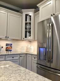 gray kitchen cabinets with white crown molding durham glacier gray cabinets with chefs kitchen crown