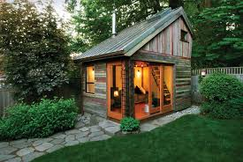 Tiny House Studio | cozy fireplace reclaimed wood in tiny backyard studio office
