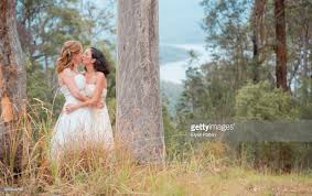 wedding backdrop australia two brides a after their wedding ceremony in australia