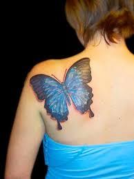 blue butterfly on back shoulder