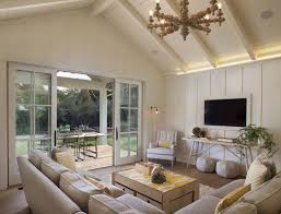 vaulted ceiling living room beams brown fabric area rug light