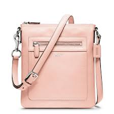 light pink coach wallet category