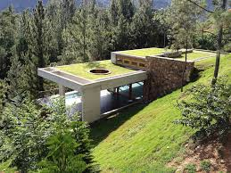 homes built into hillside grass roofed home built into slope uses hillside for cooling