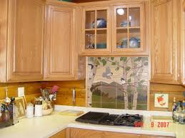light brown ceramic backsplash for kitchen between stained wooden