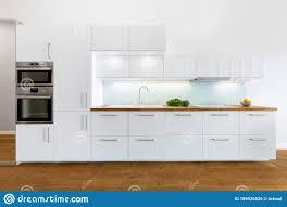 modern white kitchen cabinets wood floor modern white kitchen with wooden elements stock image