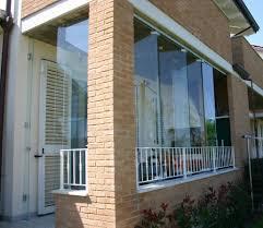vetrata veranda pareti in vetro sistemi ad impacchettamento vetreria a rimini