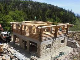 log house building a stone and log house in france