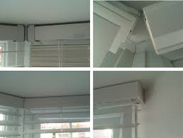 Blinds For Angled Windows - fitting wooden blinds in an angled bay made to measure blinds