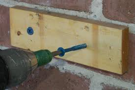 concrete screws to to concrete drill and attach shed