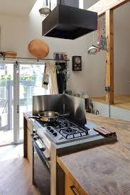 kitchen island with range space conscious japanese family home in wood and concrete decor