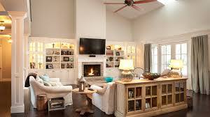 Open Twostory Family Room With White Builtin Bookshelves Brick - Two story family room