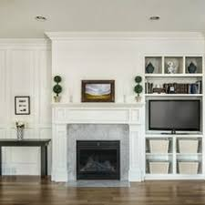 Bookcase Fireplace Designs Asymetrical Built In Bookcase With Tv And Fireplace Design Ideas