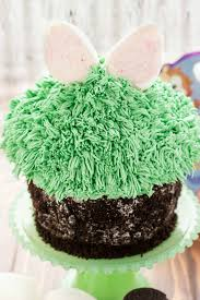 giant cupcake for easter bunny hiding in the grass the cookie