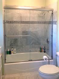 frameless sliding bath tub door with header bathrooms