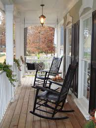 front porch decoration using pair of black stained wooden rocking