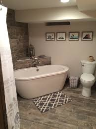 Basement Bathroom Renovation Ideas Basement Bathroom Freestanding Tub Gray Wood Porcelain Tile
