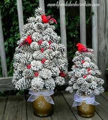 pine cone tree with snow berries and cardinals so for