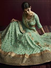 green color heavy embroidered wedding lehenga buy online by nakkashi