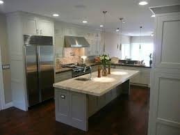 wood floors grey island white cabinets light counters and